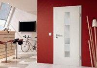 Díszrácsos ajtók keskeny üvegkivágással